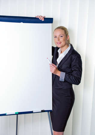 a young woman with a flip-chart board during a presentation  training and adult education  photo