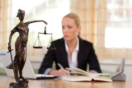court: a young lawyer is sitting at her desk in the office