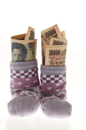 births: children socks with japanese yen geldscheinen förderungen of children  Stock Photo