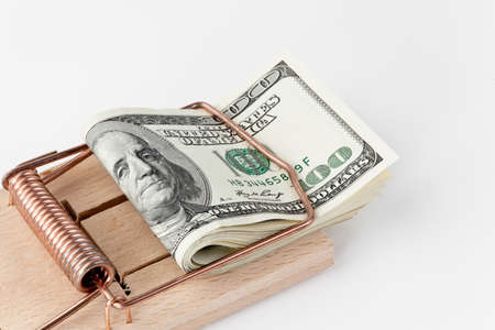 many american dollar bills in mousetrap Stock Photo - 15220002