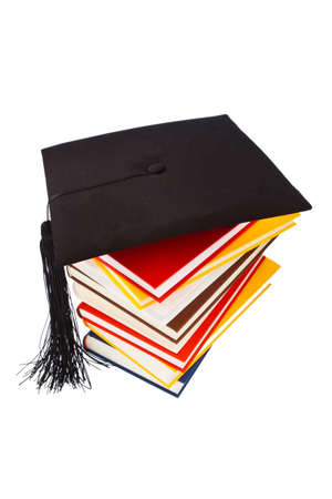 dissertation: a mortarboard on a book stack on white background  icon image for costs in training and education