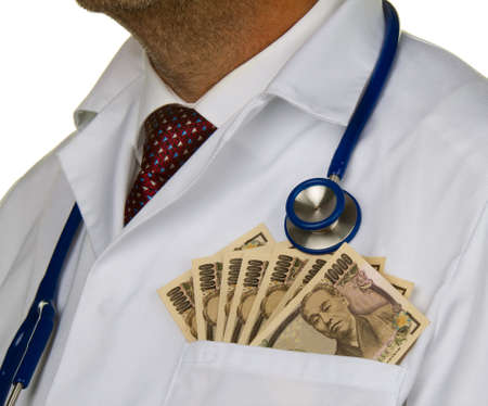 a doctor with japanese yen bank notes photo