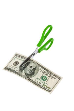 indebtedness: u s  dollars bills and scissors Stock Photo
