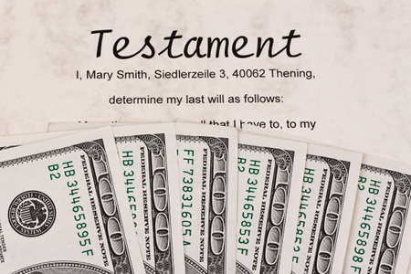many dollar bills and english testament Stock Photo - 14990067