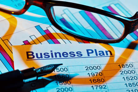 the business plan for a company or business establishment  planning a young entrepreneur Stock Photo - 14998490