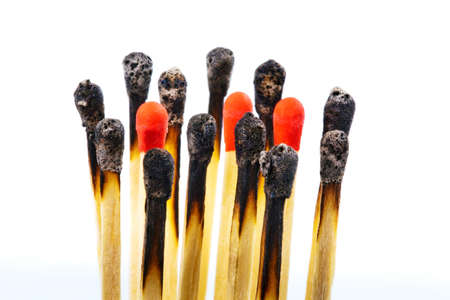 racism: many burned matches and new side by side  photo icon for integration