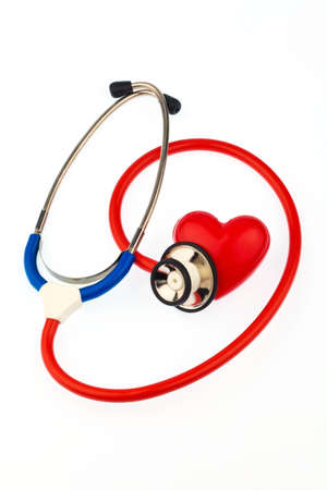 a stethoscope and a heart on a white background  prevention of heart disease Stock Photo