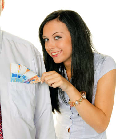 births: young woman pulls a man out of his pocket swiss francs