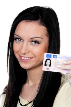 woman with car keys and driver s license  driving test photo