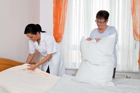 a nurse in elderly care for the elderly in nursing homes photo