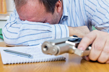 unemployed: a farewell letter and the gun of a suicide
