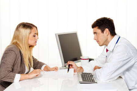 familiy: medical consultation  patient and doctor talking to a doctor s office