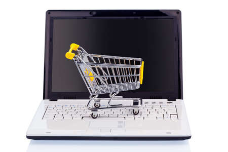 online safety: a cart and a computer keyboard  symbol photo online shopping