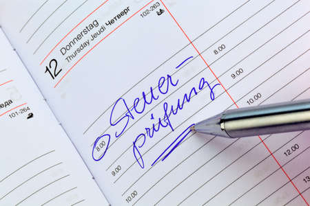 auditors: a date is entered in a calendar  tax audit