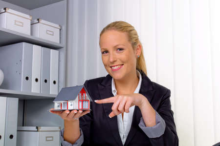 lodger: a young realtor with a model house in her office