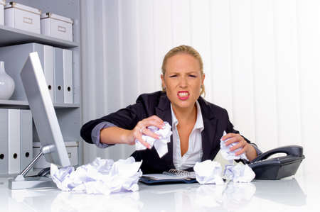 incidence: a woman in the office with paper balls  anger, stress and frustration in the workplace
