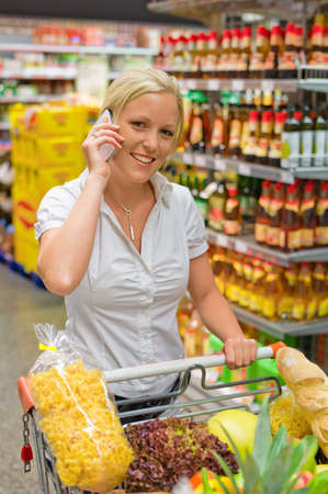 a woman when buying food in a supermarket  everyday life of a housewife Stock Photo - 15652516