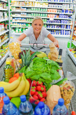 a woman when buying food in a supermarket  everyday life of a housewife Stock Photo - 15652455
