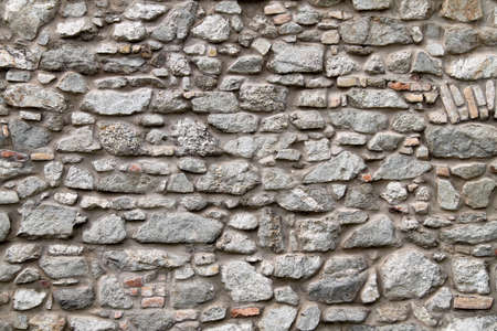 rock stone: a beautiful stone wall as a background for text and fonts  Stock Photo
