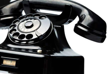 an old, old landline telephone  phone on white background Stock Photo - 15659764