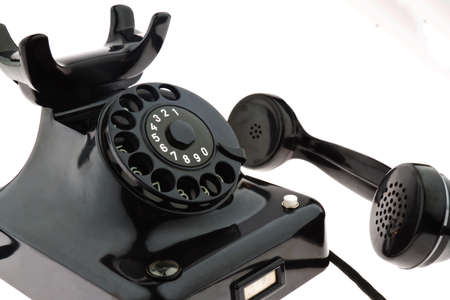 an old, old landline telephone  phone on white background  photo
