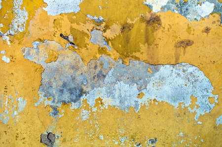 substantiate: chipped yellow paint on a building  symbolic photo for moisture and damp walls  Stock Photo
