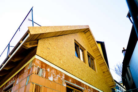 private insurance: construction of a family house under construction  solid construction with brick and wood Editorial