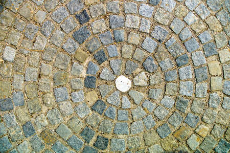 granite paving stones were laid in a square in circles representative photo of bullying and outsider