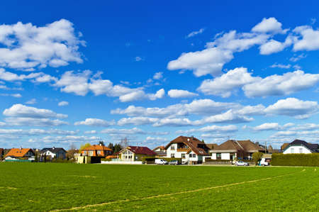 reported: a housing estate of detached houses in front of a box  spatial planning in austria Stock Photo