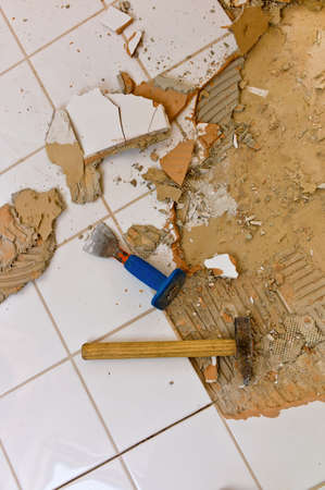 broken tiles in the renovation of a bathroom  remodeling and renovation in the living area  photo
