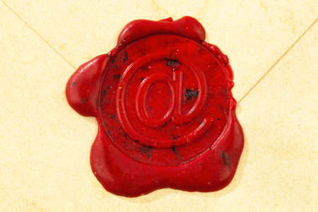 sealing wax: an envelope is sealed with the sign  the e-mail icon   symbolic photo for internet and e-mail traffic