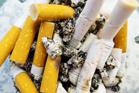 fag: many of cigarette butts lie in an ashtray