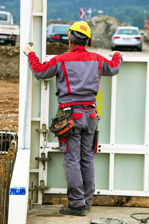 statics: construction worker at a building formwork for concrete work  construction of an industrial building Stock Photo