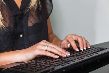 a woman with a computer keyboard. working in the office photo