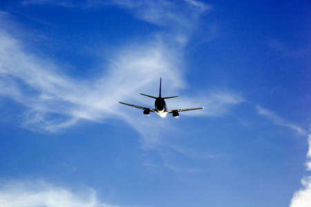 long haul journey: an airplane takes off on a vacation trip from the airport  sky and space for text Stock Photo