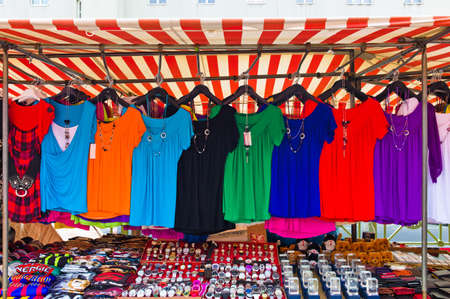 proper: many colorful shirts for sale at a market entertainment  competition for textile trading
