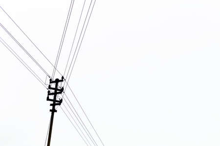 a power poles for luminous flux on a house roof. Stock Photo