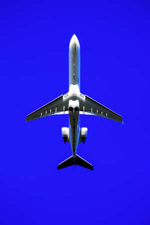 an airplane at the start of the holiday in front of blue sky. photo