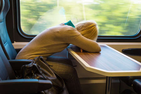 admitted: a sleeping woman on the train  travelling on a train relaxed