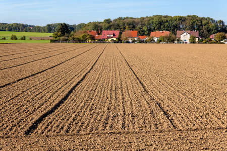 peasantry: the freshly tilled fields of the farmers  background urbanization  spatial planning and regional planning  Stock Photo