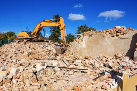 condemned: a house is being demolished  excavators at the site  after demolition, new housing is created