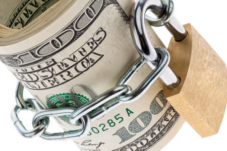 commissions: many dollar bills are locked with a lock