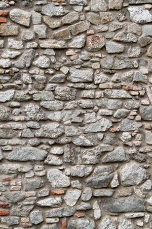 warns: a beautiful stone wall as a background for text and fonts  Stock Photo