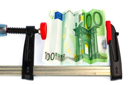 austerity: a euro bank note in vise  economic and financial crisis