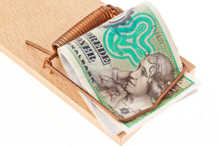 danish crowns  currency from denmark in europe in a mousetrap  debt and budget Stock Photo - 16331177