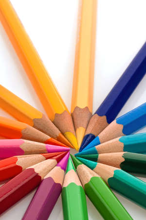 many different colored pencils on a white background  photo