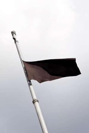 peoplesoft: a black flag at half mast after a death