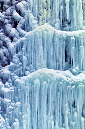 icescape: a frozen by the cold waterfall  icy waterfall in winter  Stock Photo