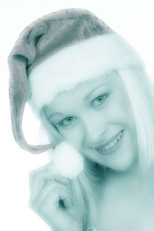 bobble: a young woman with the cap of a santa claus  christmas woman on christmas in front of white background