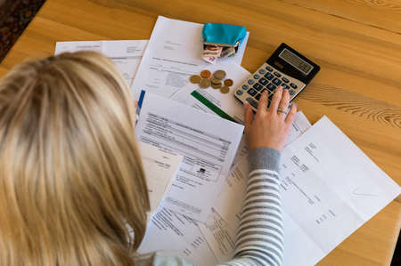 insolvency: a woman with unpaid bills has many debts Stock Photo